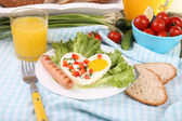 Scrambled egg with sausage and vegetables served in plate on fabric background — Stock Photo