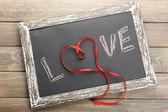Love written on chalkboard — Stock Photo