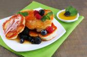 Pancakes with berries and honey — Stock Photo