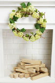 Fireplace with wreath — Stock Photo
