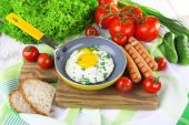 Scrambled egg with sausage — Stock Photo
