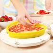 Baking tasty pie and ingredients for it on table in kitchen — Stock Photo #53690555