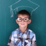 Funny Schoolboy at blackboard — Stock Photo #53693487