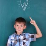 Funny Schoolboy at blackboard — Stock Photo #53693493