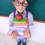 Funny Schoolboy at blackboard — Stock Photo #53693539
