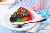 Delicious rainbow cake on plate, on table, on light background — Stock Photo