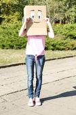 Woman with cardboard box — Stock Photo