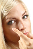 Young woman with contact lens — Stock Photo