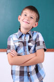 Funny Schoolboy at blackboard — Stock Photo