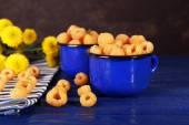 Raspberries in dark blue mugs — Stock Photo