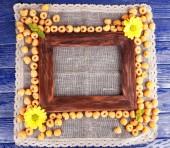 Yellow raspberries with wooden photo frame — Stock Photo