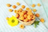 Yellow raspberries in basket — Stock Photo