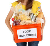 Girl volunteer with donation box — Stock Photo