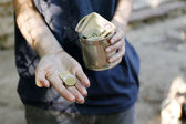 Homeless beggar money on his dirty hands — Stock Photo