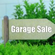 Garage sale sign at park — Stock Photo #53853997