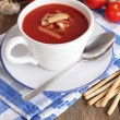 Tasty tomato soup with croutons on wooden table — Stock Photo #53857255