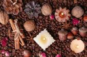 Candles on vintage tray with coffee grains and spices, bumps on color wooden background — Stock Photo