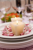 Buffet table with dishware and candles waiting for guests — Stock Photo