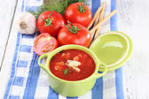 Tasty tomato soup with croutons on table close-up — Stock Photo