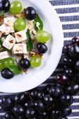 Tasty salad with grape and cheese, close up — Stock Photo