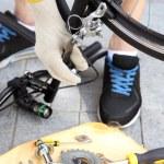 Man repairing his bike, close-up — Stock Photo #53861847