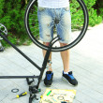 Man repairing his bike, close-up — Stock Photo #53861859