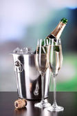 Champagne in glasses and bottle in restaurant — Stock Photo