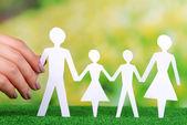 Hand holding paper family — Foto de Stock