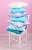 Bright pillows on chair — Foto de Stock