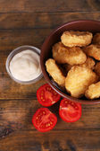 Chicken nuggets with sauce — Stock Photo