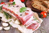 Bacon with bread and spices — Stock Photo