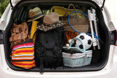 Suitcases in trunk of car — Stock Photo