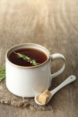 Cup of tasty herbal tea — Stock Photo