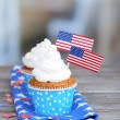 American patriotic holiday cupcakes on wooden table — Stock Photo #54028039