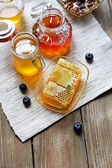 Fresh honey on wooden table — Stock Photo