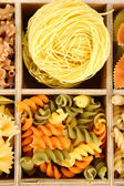 Colorful pasta in wooden box, close-up — Stock Photo