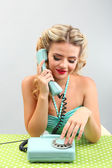 Beautiful girl with old telephone — Stock Photo