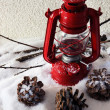 Red flash light and Christmas decoration on light background — Stock Photo #54034123