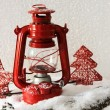 Red flash light and Christmas decoration on light background — Stock Photo #54034167
