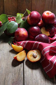 Sweet plums on wooden background — Stock Photo