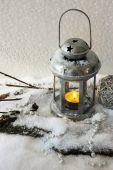 Metal flash light and Christmas decoration on light background — Stock Photo