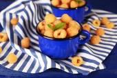 Yellow raspberries in blue mugs — Stock Photo