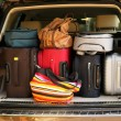 Suitcases and bags in trunk of car ready to depart for holidays — Stock Photo #54042055