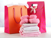 Baby clothes and gift bags — Stockfoto