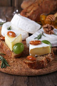Camembert cheese on paper — Foto Stock