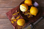 Lemons, nuts and grater — Stock Photo