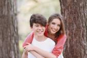 Beautiful young couple in park — Stock Photo