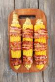 Grilled bacon wrapped corn on table, close-up — Stock fotografie