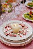 Buffet table with dishware and candle waiting for guests — Stock Photo