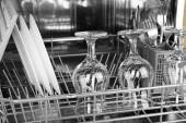 Open dishwasher with clean utensils in it — Stock Photo